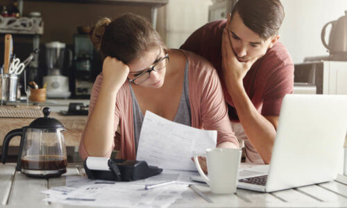 Confused Couple Looking Over Health Cover