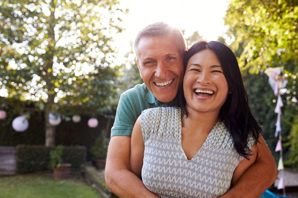 Australian couple in their backyard: health insurance comparison